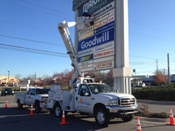 Custom Print Product Bucket Truck installing a professional sign